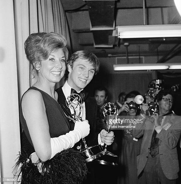 American actors Michael Learned and Richard Thomas each hold their Emmy Awards for Outstanding Continued Performance in a Leading Role Hollywood...