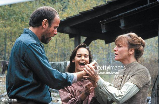 American actors Michael Moriarty Sydney Penny and Carrie Snodgress on the set of Pale Rider directed and produced by Clint Eastwood