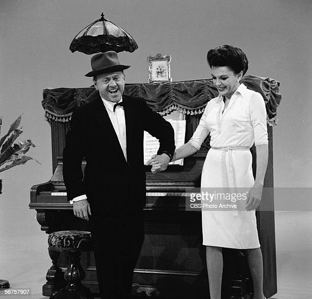 American actors Mickey Rooney and Judy Garland hold hands on the set of 'The Judy Garland Show' December 8 1963