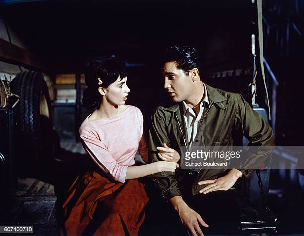 American actors Millie Perkins and Elvis Presley on the set of Wild in the Country directed by Philip Dunne