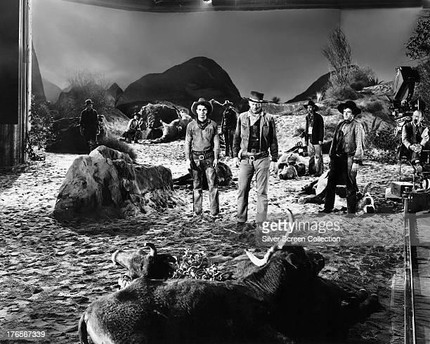American actors Montgomery Clift as Matthew 'Matt' Garth John Wayne as Thomas Dunson and Noah Beery Jr as Buster McGee on the set of 'Red River'...