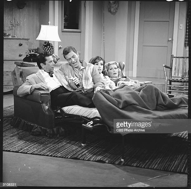American actors Morey Amsterdam and Rose Marie attempt to share a foldabed with Dick Van Dyke and Mary Tyler Moore who play married couple Rob and...