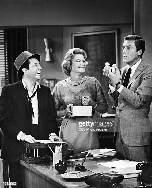 American actors Morey Amsterdam and Rose Marie smile as actor Dick Van Dyke holds up two ducklings in a still from the television series 'The Dick...