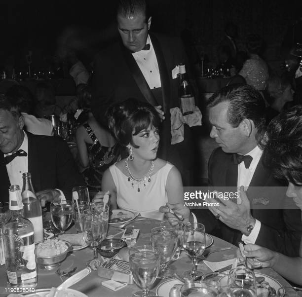 American actors Natalie Wood and David Janssen in conversation at a Cystic Fibrosis benefit at the Century Plaza Hotel in Los Angeles California USA...