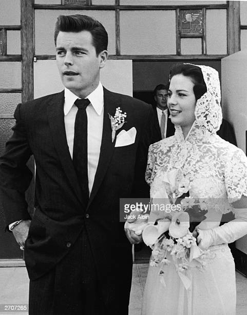 American actors Natalie Wood and Robert Wagner stand outside the church holding hands on their wedding day Scottsdale Arizona December 28 1957