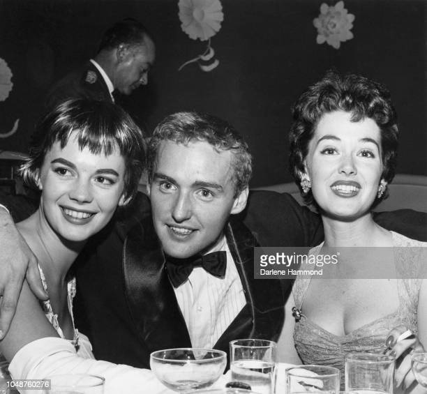 American actors Natalie Wood Dennis Hopper and Barbara Rush at the Mocambo nightclub after the premiere of 'Giant' West Hollywood California 17th...