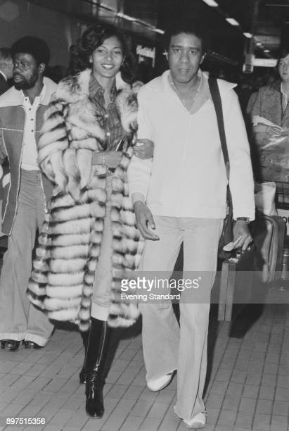 American actors Pam Grier and Richard Pryor at Heathrow airport, London, UK, 1st April 1977.