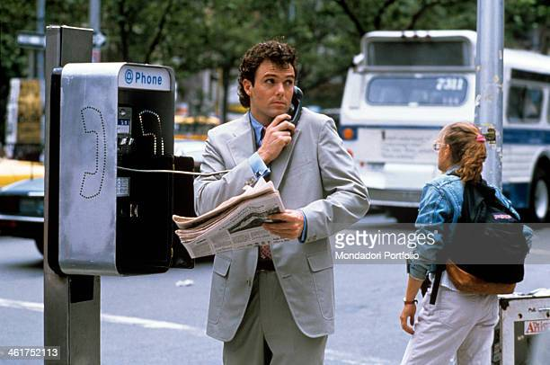 American actors Patrick Cassidy making a call from a public phone in the film Longtime Companion USA 1989