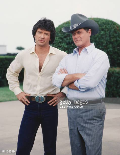 American actors Patrick Duffy and Larry Hagman as Bobby Ewing and John Ross 'JR' Ewing Jr stand together in a promotional still from the American...