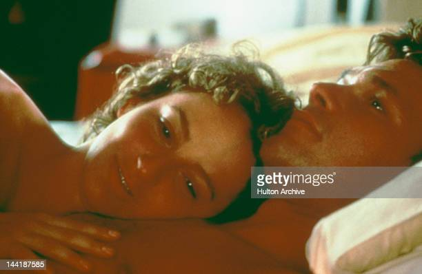 American actors Patrick Swayze and Jennifer Grey enjoy a post-coital moment in the film 'Dirty Dancing', 1987.
