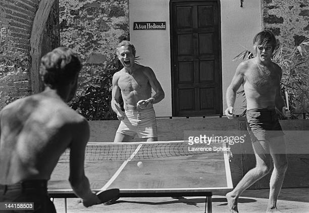 American actors Paul Newman and Robert Redford play pingpong during a break in the filming of their movie 'Butch Cassidy and the Sundance Kid'...