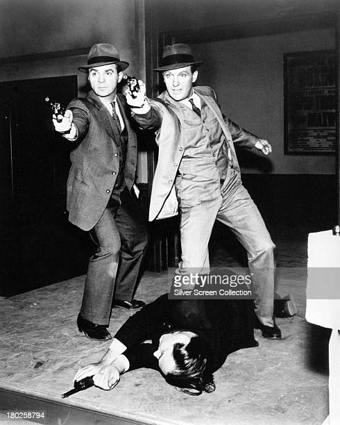 American actors Paul Picerni as Lee Hobson and Robert Stack as Eliot Ness in the TV crime series 'The Untouchables' circa 1960