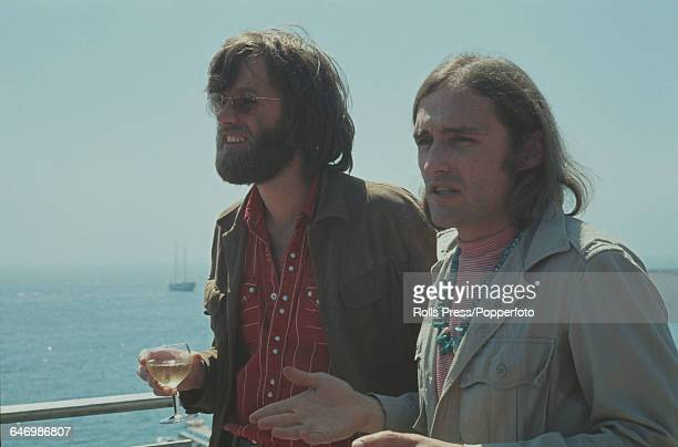 American actors Peter Fonda and Dennis Hopper pictured together holding glasses of white wine in Cannes France to promote their film 'Easy Rider' at...