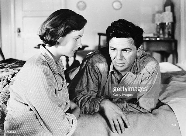 American actors Phyllis Thaxter and John Garfield in a still from the film 'The Breaking Point' directed by Michael Curtiz 1950