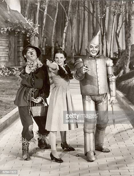 American actors Ray Bolger Judy Garland and Jack Haley as the Scarecrow Dorothy and the Tin Woodsman respectively in a promotional still from the...