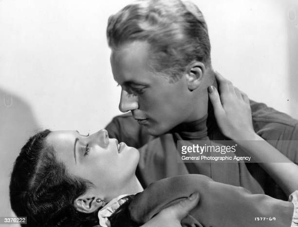 American actors Raymond Gene and Marguerite Churchill in a scene from the film 'Forgotten Commandments'
