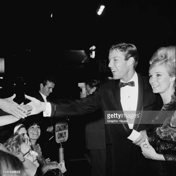 American actors Richard Chamberlain and Yvette Mimieux attend the premiere of 'The Unsinkable Molly Brown' US 11th June 1964