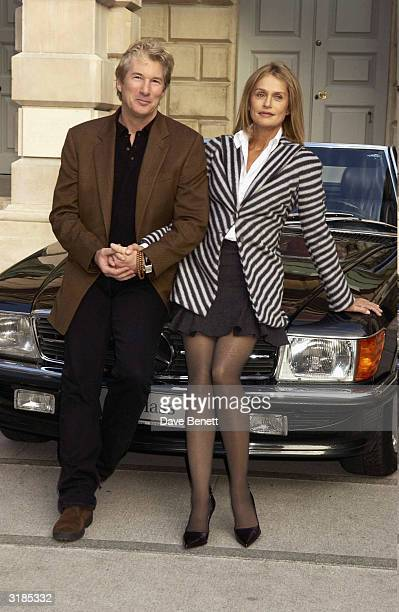 American actors Richard Gere and Lauren Hutton attend the Giorgio Armani Retrospective at the Royal Academy posing with the Mercedes Benz and Armani...