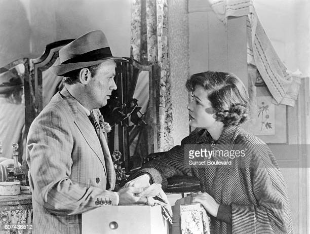 American actors Richard Widmark and Gene Tierney on the set of Night and the City, based on the novel by Gerald Kersh, and directed by Jules Dassin.