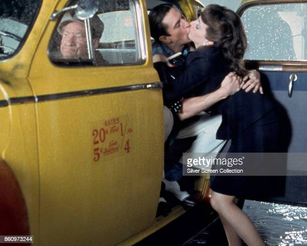 American actors Robert De Niro and Liza Minelli kiss one another in the open door of a cab in a scene from 'New York New York' 1977 The cab driver at...