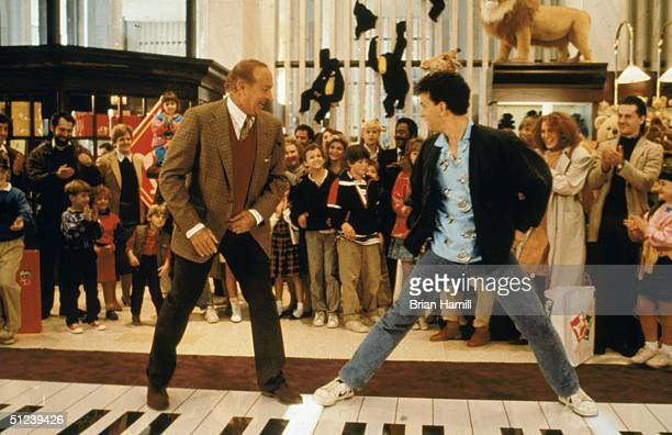 1988 American actors Robert Loggia left and Tom Hanks stand on a giant piano keyboard at the FAO Schwartz toy store in a still from the film 'Big'...