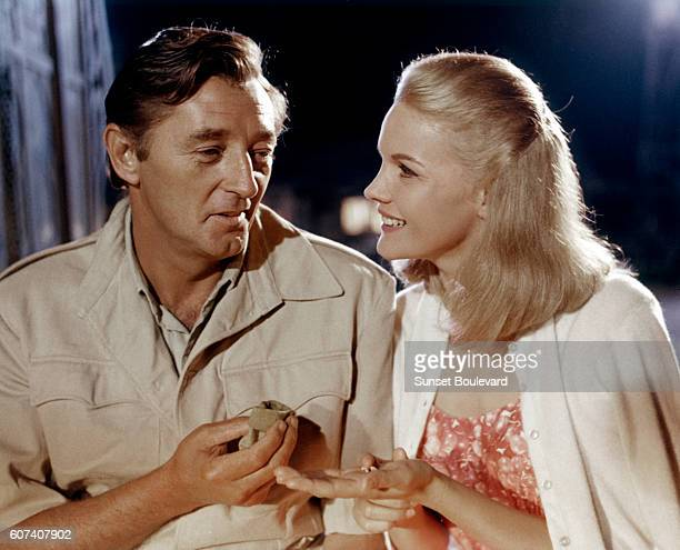 American actors Robert Mitchum and Carroll Baker on the set of Mister Moses directed by Ronald Neame