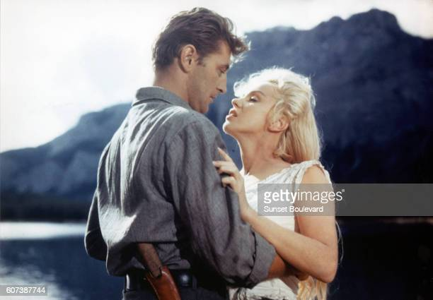 American actors Robert Mitchum and Marilyn Monroe on the set of River of No Return directed by Austro–HungarianAmerican Otto Preminger