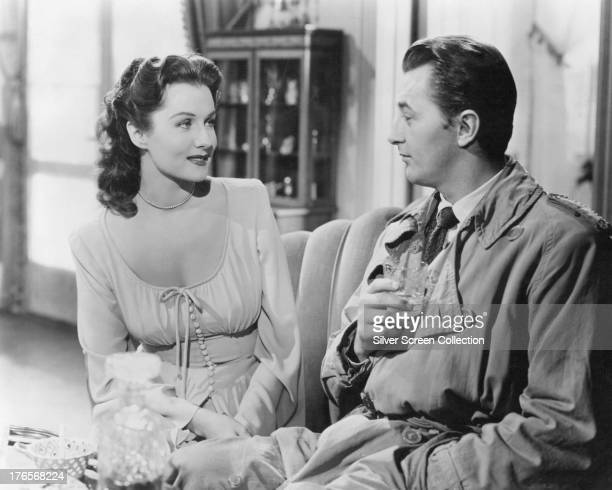 American actors Robert Mitchum as Jeff Bailey and Rhonda Fleming as Meta Carson in 'Out Of The Past' aka 'Build My Gallows High' directed by Jacques...