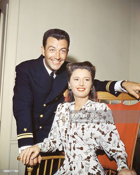 American actors Robert Taylor and his wife Barbara Stanwyck circa 1945 Taylor is wearing the uniform of the United States Naval Air Corps