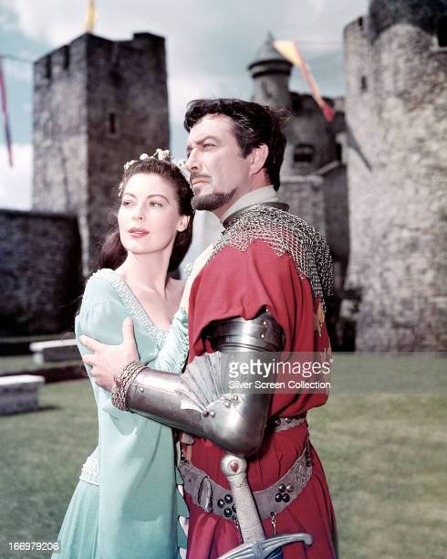 American actors Robert Taylor as Sir Lancelot and Ava Gardner as Queen Guinevere in a promotional portrait for 'Knights Of The Round Table' directed...