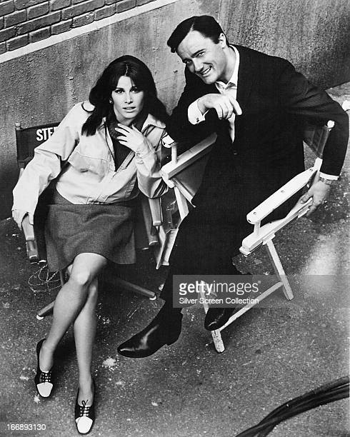 American actors Robert Vaugn and Stefanie Powers in director's chairs on the set of the TV series 'The Girl from UNCLE' circa 1966