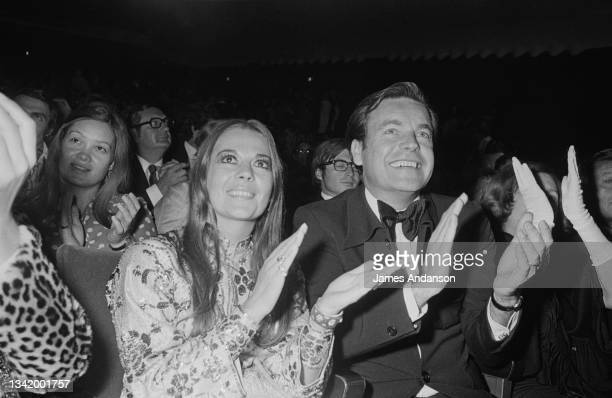 American actors Robert Wagner with wife Natalie Wood, attend the premiere of Bulgarian-born French singer Sylvie Vartan, at the Olympia music hall,...