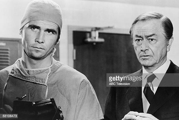American actors Robert Young and James Brolin dressed in surgical scrubs and cap stand together in a still from episode 'Ask Me Again Tomorrow' from...