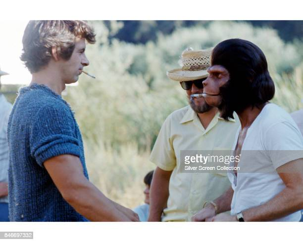 American actors Roddy McDowall as Galen and James Naughton as Pete Burke take a break on the set of science fiction television series 'Planet of the...