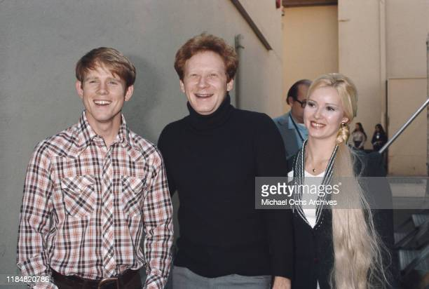 American actors Ron Howard and Don Most , stars of the television sitcom 'Happy Days', with a young woman, circa 1975.