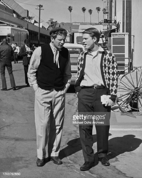 American actors Ron Howard and Donny Most on the studio lot during the filming of the television sitcom 'Happy Days', USA, 1977. The Hollywood sign...