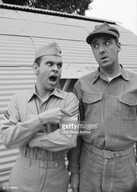 American actors Ronnie Schell and Jim Nabors stand outside a Quonset hut during the filming of an episode of the television comedy series 'Gomer Pyle...