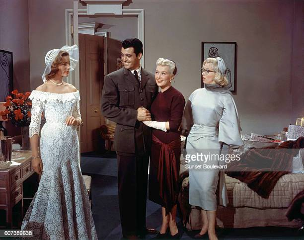 American actors Rory Calhoun Lauren Bacall Betty Grable and Marilyn Monroe on the set of How to Marry a Millionaire directed by Jean Negulesco