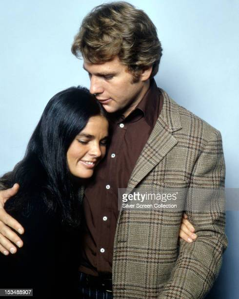 American actors Ryan O'Neal and Ali MacGraw in a promotional still for 'Love Story' directed by Arthur Hiller 1970