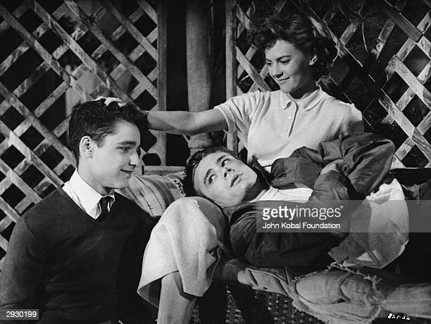American actors Sal Mineo James Dean and Natalie Wood in a scene from the film 'Rebel Without a Cause' directed by Nicholas Ray 1955