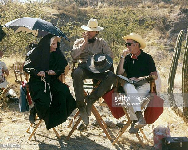 American actors Shirley MacLaine and Clint Eastwood with director Don Siegel on the set of Two Mules for Sister Sara directed by Don Siegel