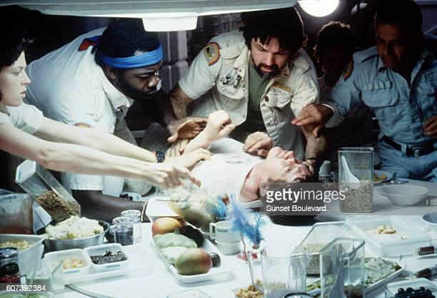 American actors Sigourney Weaver Yaphet Kotto Tom Sherritt British actors John Hurt and Ian Holm on the set of Alien directed by Ridley Scott