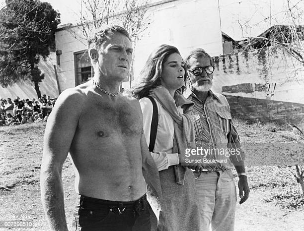 American actors Steve McQueen and Ali MacGraw with director Sam Peckinpah on the set of his movie The Getaway