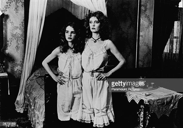 American actors Susan Sarandon and Brooke Shields stand together wearing matching slips in a still from the film 'Pretty Baby' directed by Louis...