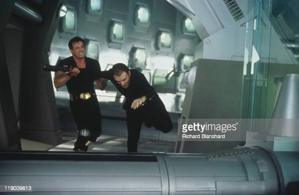 American actors Sylvester Stallone and Armand Assante star in the dystopian scifi film 'Judge Dredd' 1995