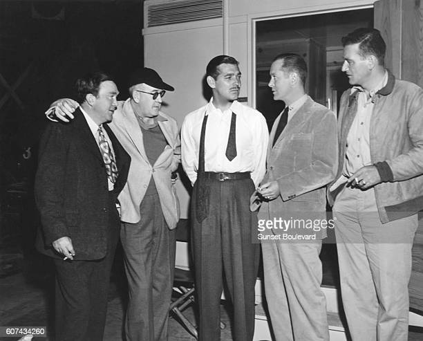 American actors Thomas Mitchell Clark Gable Robert Montgomery and John Wayne with director and producer John Ford on the set of his movie They Were...