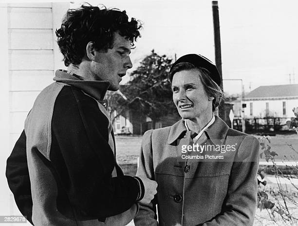 American actors Timothy Bottoms and Chloris Leachman speak outdoors in a still from the film 'The Last Picture Show' directed by Peter Bogdanovich...