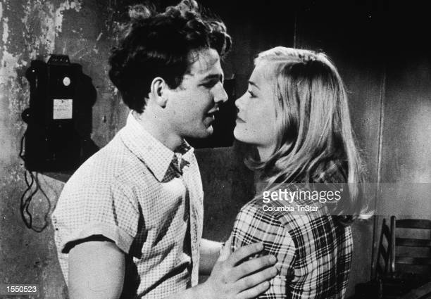 American actors Timothy Bottoms and Cybill Shepherd embrace in a still from the film 'The Last Picture Show' directed by Peter Bogdanovich 1971