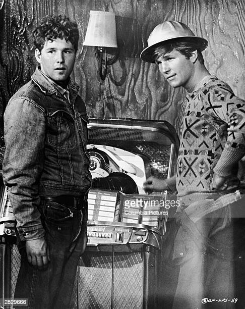 American actors Timothy Bottoms and Jeff Bridges stand by a juke box in a still from the film 'The Last Picture Show' directed by Peter Bogdanovich...