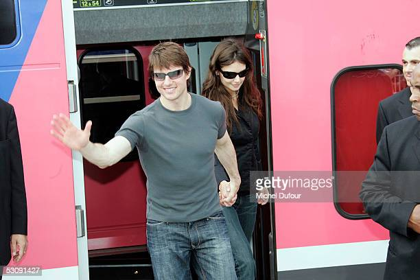 American actors Tom Cruise and fiancee Katie Holmes wave to fans before boarding a TGV train to Marseille for this evening's French premiere of his...